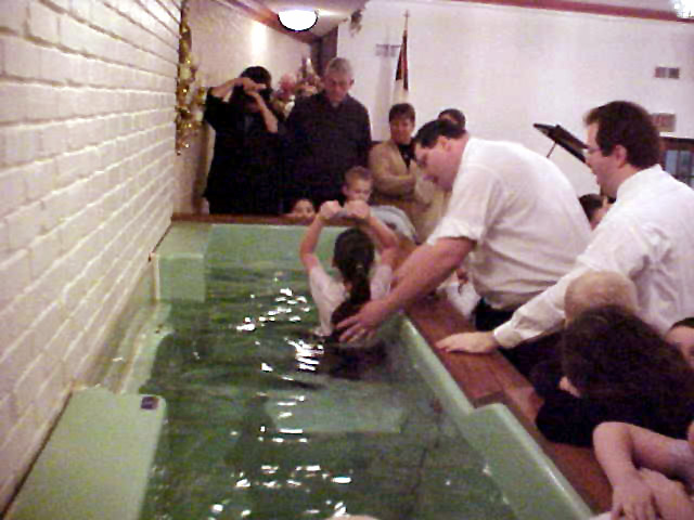Brother Tom Morris prepares to baptize his oldest daughter, Anastasia. She  had already received the Holy Ghost.